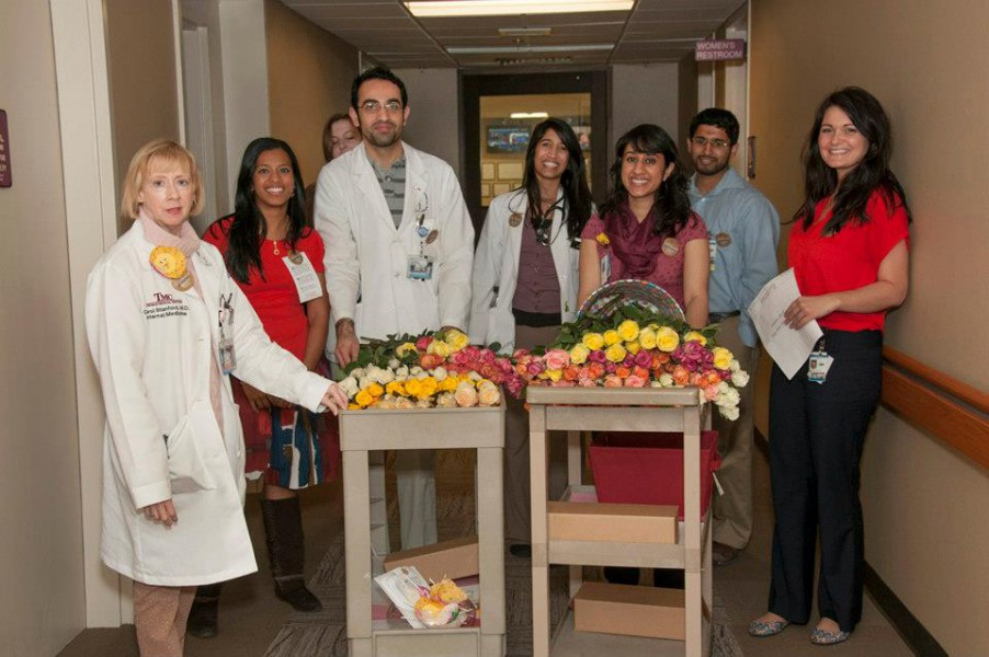 Members of the School of Medicine chapter of the Gold Human Honor Society delivered roses and cards to patients and hospital staff at Truman Medical Center during their rounds on Valentine's Day.