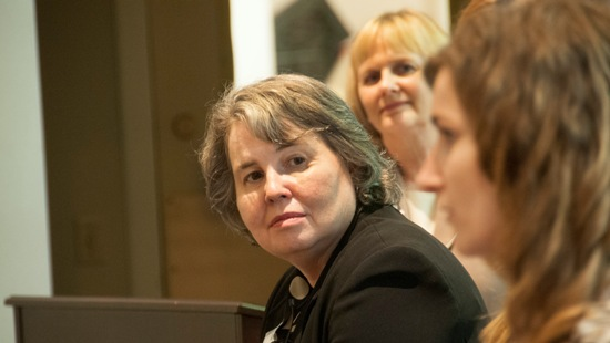 """School of Medicine Dean Betty Drees, M.D. listens to a panelist during the Central Exchange's June 26 panel discussion on """"The Intersection Point of Women, Science, Technology and Medicine."""""""