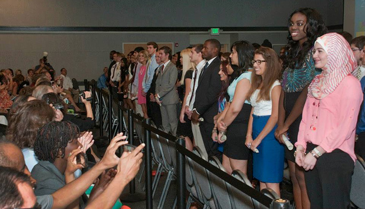 Family and freinds were busy capturing the moment during the introduction of the Year 1 class at the School of Medicine's 2013 InDOCtrination Ceremony on Aug. 16 at Pierson Auditorium.