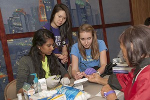 Meghna Singh, Lauren Thai and Rachel Crockett take part in the the health screenings at the annual Fun and Fitness Day.