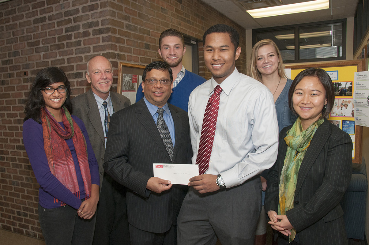 Joseph Melookaran, president of the Asian American Chamber of Commerce of Kansas City, presented a $1,000 check to Sean Davidson, officer of the UMKC Chapter of GlobeMed, to support the group's work in providing health and economic improvements to impoverished areas overseas. Pictured are Isha Jain, MS 4, GlobeMed alumna, Stuart Munro, M.D., chairman of the Department of Medical Humanities and Social Sciences, Melookaran, Parker Webb, politcal science major and GlobeMed officer, Davidson, AnnaMaria Maples, MS 2, GlobeMed officer, and Sook Park, executive director of the Asian American Chamber of Commerce.