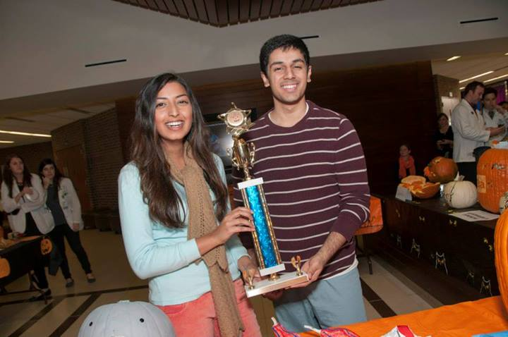 Joan Chandra, MS 4, and Harris Choudhry, MS 4, show off the first prize trophy on Oct. 31 after their Green 8 docent team won this year's School of Medicine Pumpkin Carving Contest.