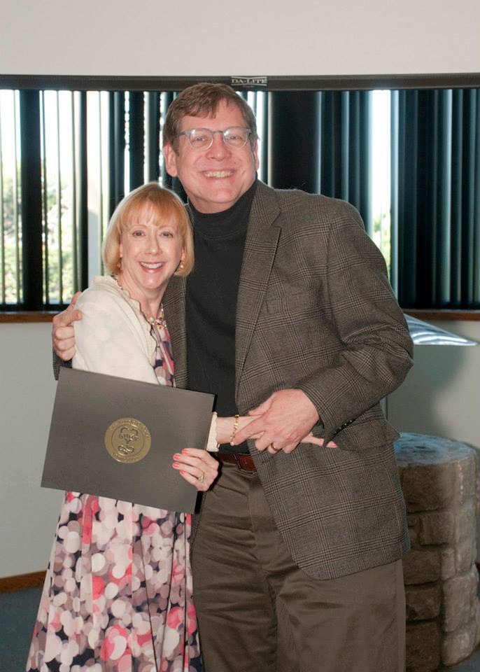 Carol Stanford, M.D., faculty sponsor for the UMKC School of Medicine's Gold Humanism Honor Society, recognized George Thompson, M.D., associate professor of medical humanities and social sciences, as one of the 2014 GHHS inductees on April 5.