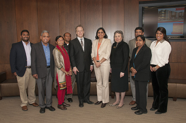 Tejal K. Gandhi, M.D., M.H.P., C.P.P.S, president of the National Patient Safety Foundation, (sixth from left) presented the keynote lecture at the inaugural Vijay Babu Rayudu Quality and Patient Safety Day at the School of Medicine on April 11. Dr. Gandhi is pictured with Peter Almenoff, M.D., Vijay Babu Rayudu Endowed Chair of Patient Safety (fifth from left), School of Medicine Dean Betty M. Drees, M.D., (next to Dr. Gandhi), and the family of Vijay Babu Rayudu.