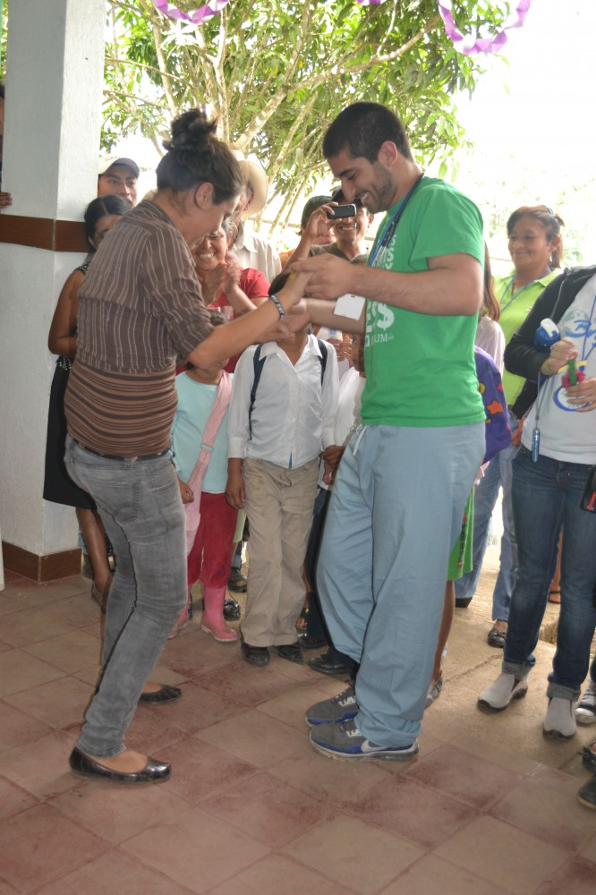 A local woman teaches Omar Karadaghy, MS 4, president of the UMKC Medical Brigade, a traditional dance during the thank you ceremony for the student volunteers in Estelí, Nicaragua.