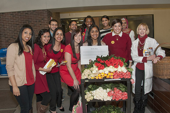 Members of the School of Medicine chapter of the Gold Humanism Honor Society and their faculty sponsor, Carol Stanford, M.D., delivered roses and Valentine's cards to patients at Truman Medical Center.