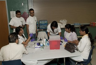 Student members of the Asian Pacific American Medical Student Association (APAMSA) take part in a health fair.