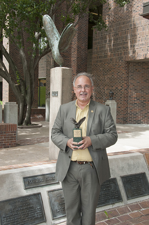 Timothy Buie, M.D. '84, received the 2015 E. Grey Dimond, M.D., Take Wing Award.