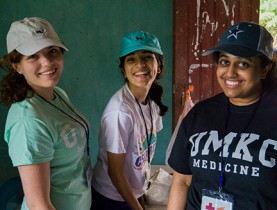 Sanju Esaran, MS 4, Komal Kumar, MS 2, and Sarah Atallah, MS 2, take a break while workin in the pharmacy.