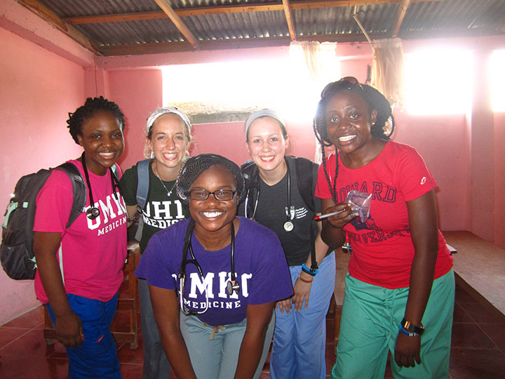 Simisola Kuye, MS 5, (left) and Nikiru Osude, MS 5, (middle) traveled to Haiti on a medical mission trip with the Student National Medical Association this past summer.
