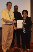Dr. Kasraie receives a 1st place award for his oral presentation