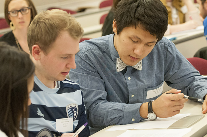 School of Medicine third-year students Jason Tucker, left, and Luke He, right, joined students from across the UMKC Health Sciences campus for an interprofessional education program on Feb. 19