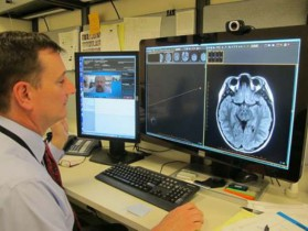 Doug Rivard, DO, Radiology Department Chair, tests the Real Presence collaboration tool with Steven Shapiro, MD, MDSA, Director-Division of Child Neurology. (Dr. Shapiro is visible on the screen to the left.)