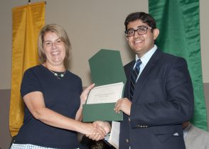 Second-year student Sarthak Garg received the 2016 Richard T. Garcia Memorial Award from Brenda Rogers, M.D., Associate Dean for Student Affairs during the School of Medicine InDOCtrination Ceremony.