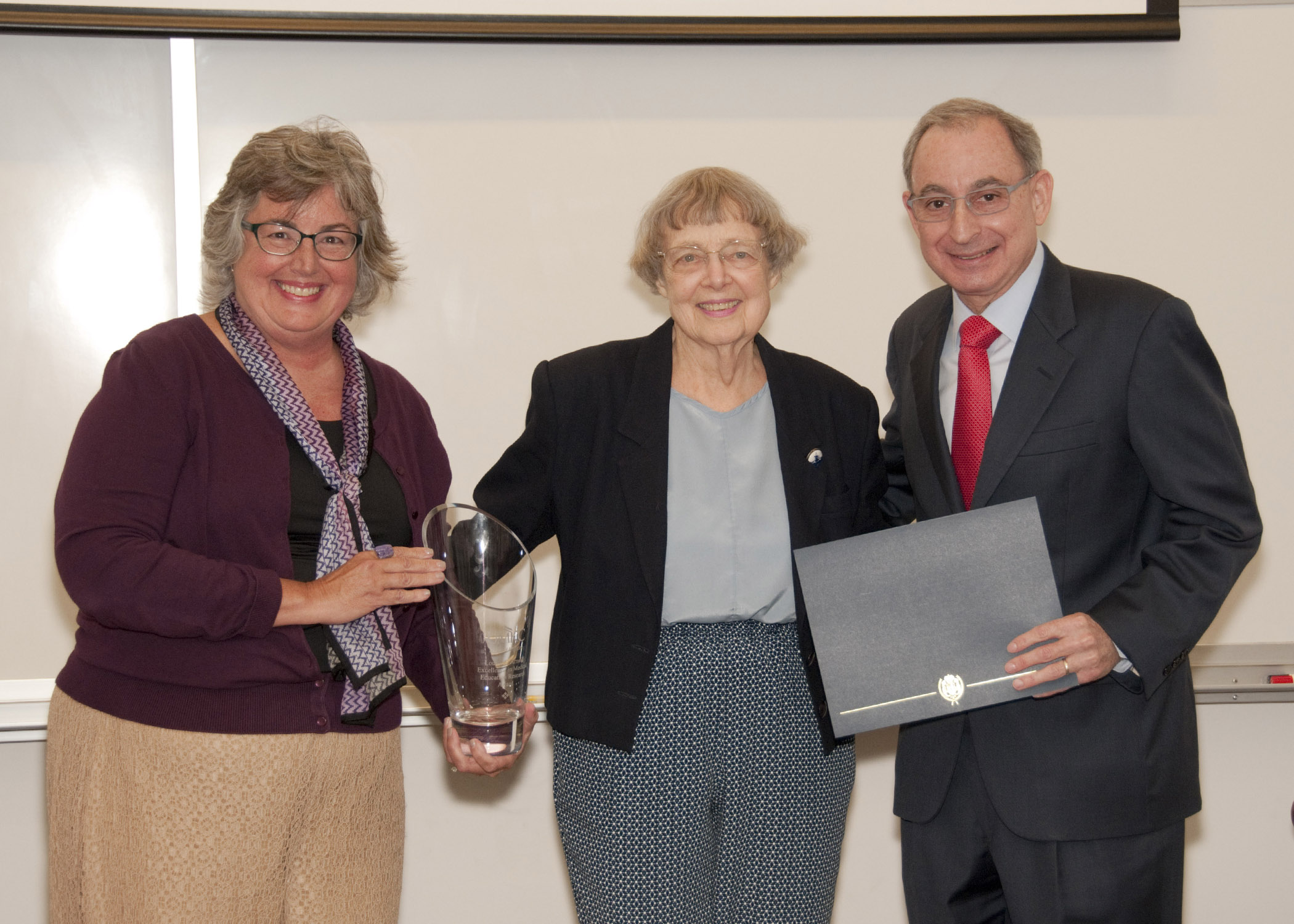 Louise Arnold, Ph.D., (middle) former associate dean for medical education and research, received the inaugural Louis E. Arnold Excellence in Medical Education and Research Award from Rebecca Pauly, M.D., F.A.C.P., associate dean for faculty development, and School of Medicine Dean Steven Kanter, M.D.