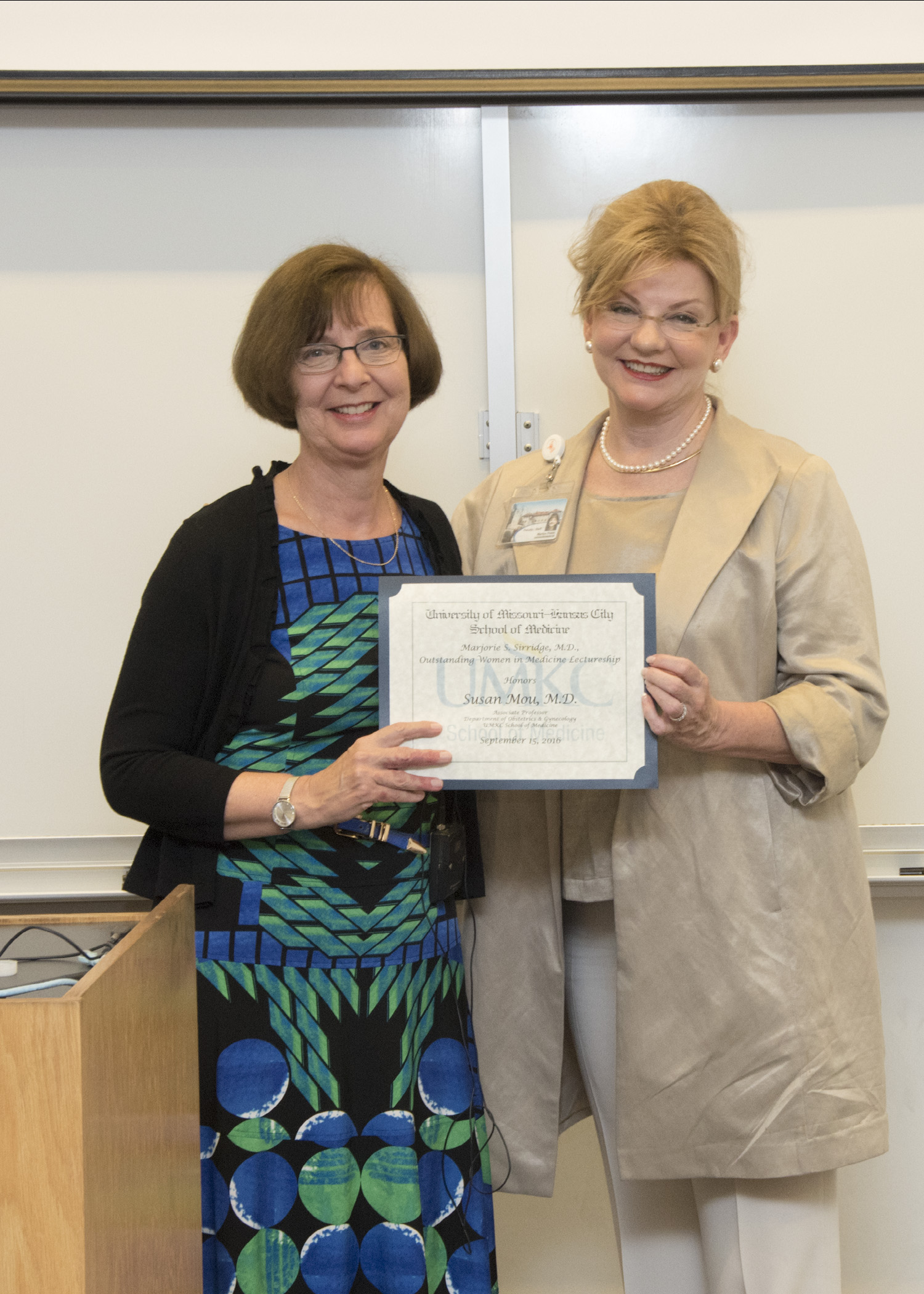 Susan Mou, M.D., delivered the 2006 Marjorie S. Sirridge (left), M.D., Outstanding Women in Medicine Lecture and was recognized afterward by Marilyn M. Pesto, director of the Sirridge Office of Medical Humanities and Bioethics.