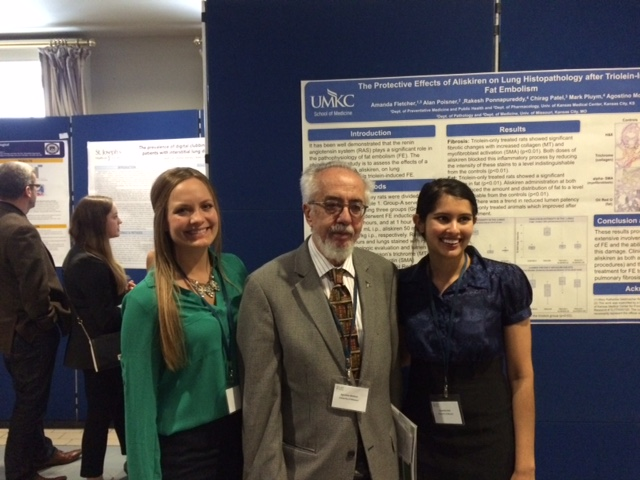 Sixth-year students Amanda Fletcher, left, and Susamita Kesh, right, made poster presentations with Agostino Molteni, M.D., Ph.D., professor of pathology and director of student research, at an international scientific conference on pulmonary fibrosis in Dublin, Ireland.