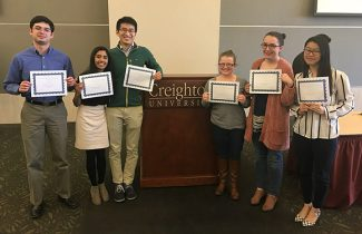 School of Medicine students Saber Khan, Becky Kurian, Yicheng Bao and Diana Jung (far right) won an interprofessional education reasoning regional competition at Creighton University in Omaha, Nebraska.