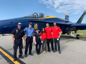 Dr. Carney, KFCD Medical Director (3rd from Left), and UMKC EM residents (starting 4th from left: Phi Dinh, Matt Twillman, and Jarret Gardner) enjoying a break at the KC Air Show while providing medical direction.