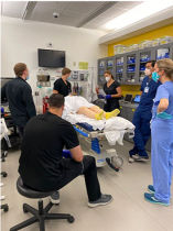 Faculty member Stefanie Ellison, MD leading an adult COVID-19 simulation to prepare our residents for the assessment and resuscitation of a critical COVID-19 patient.